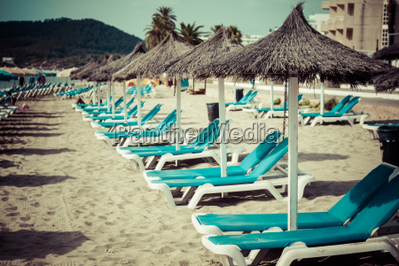 deck chairs in the sand over
