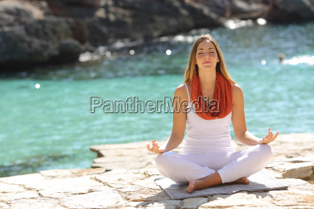 relaxed girl doing yoga exercises on