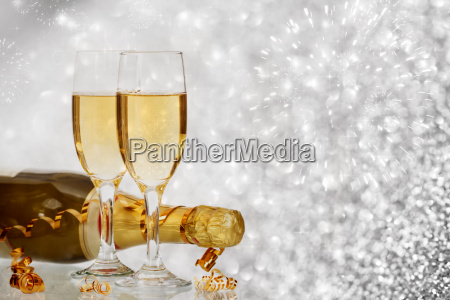 champagne against fireworks and holiday lights