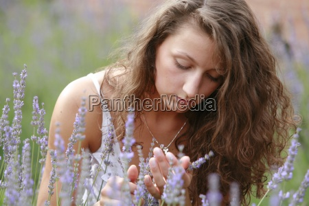 woman blue garden flower plant brown