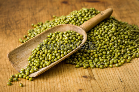 old wooden shovel with mung beans