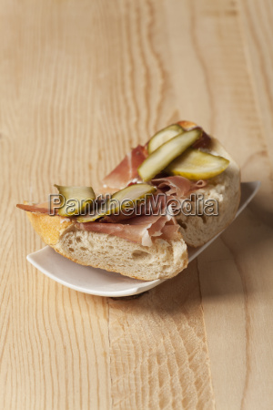 ham sandwich on a white plate