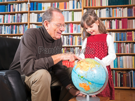 grandfather and granddaughter looking at a