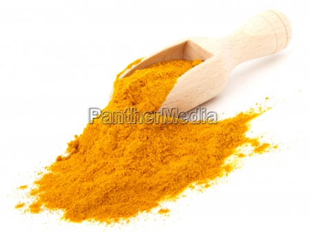 turmeric over the spoon isolated on