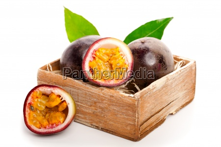 fresh passion fruit with green leaves