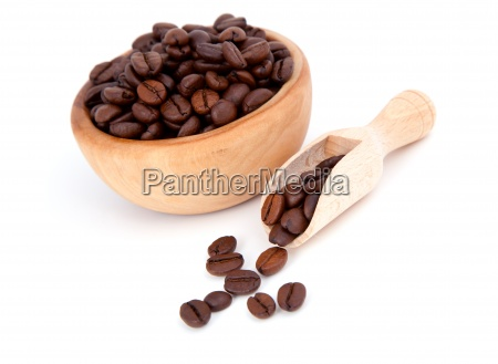coffee beans in the wooden spoon