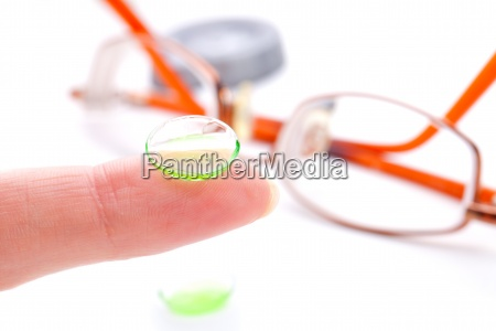 contact lens on finger isolated on
