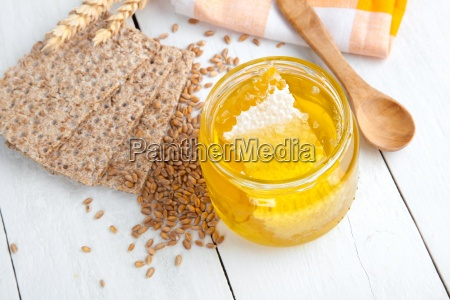 honey with a wooden spoon and