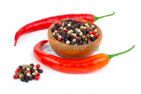 red chili and pepper on white