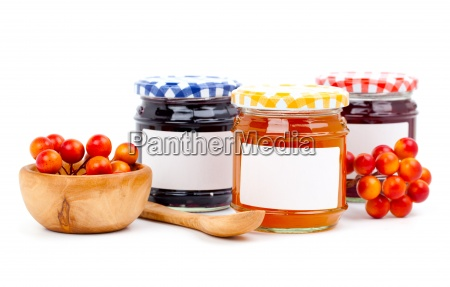 jars of jam with berries on