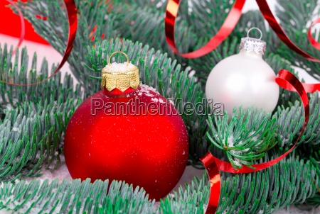 red christmas ball with pine branch