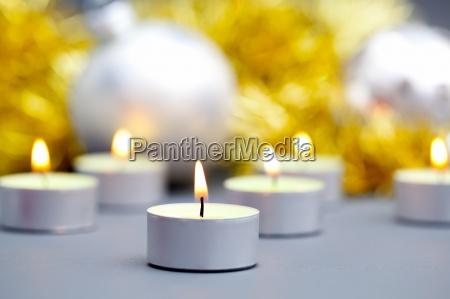 burning candles on background of christmas
