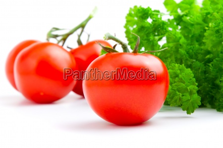 red tomato with parsley on white