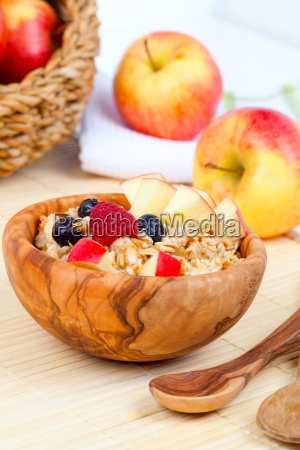 delicious oatmeal with raspberries and apple