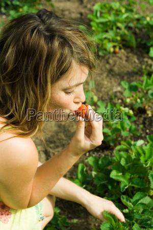 woman nibble green face field skin