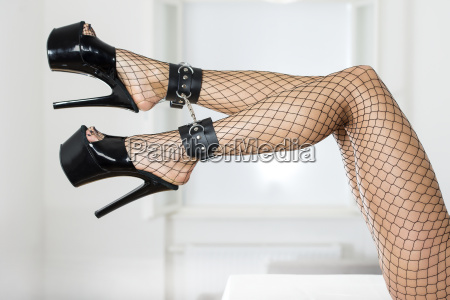 sexy legs with fishnet stockings ankle