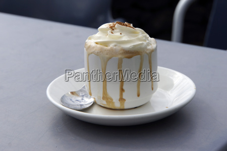 overflowing cappuccino with cream