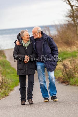senior happy couple taking a walk