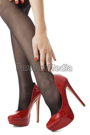 attractive female legs with black nylons