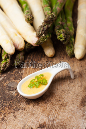 raw asparagus and sauce hollandaise