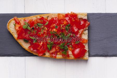 bruschetta with oregano on slate