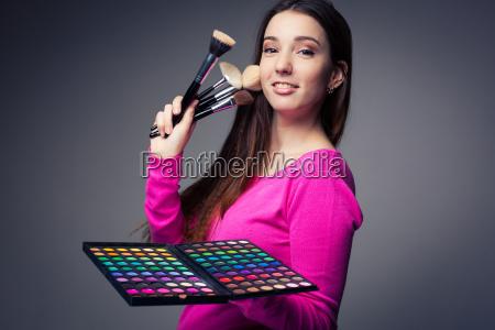 cute make up artist holding her