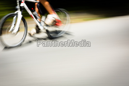 cyclist on a road bike going