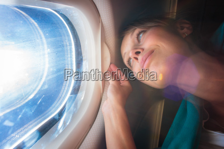 happy female airplane passanger enjoying the
