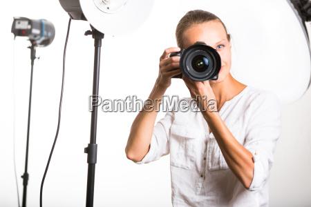 pretty female photographer with digital