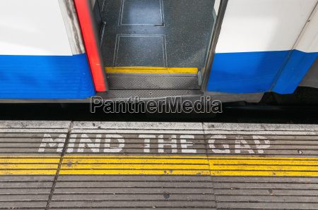 mind the gap sign with open