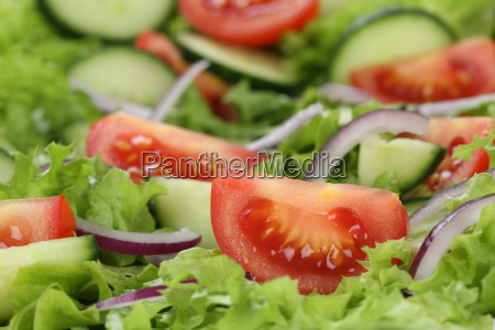 close up green salad with tomatoes