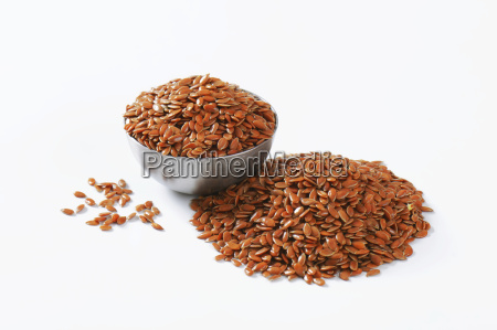 bowl of whole brown flax seeds
