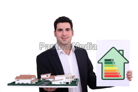 architect with an energy rating sign