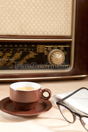 a cup of coffee with newspaper