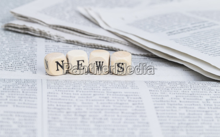 news in wood letters