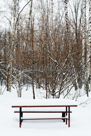 snow covered table on recreation ground