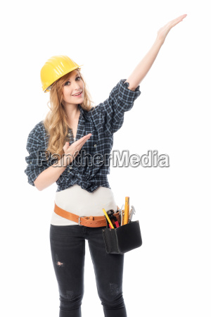 female artisan with construction helmet pointing