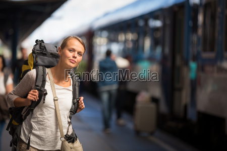 pretty young woman boarding a trainhaving