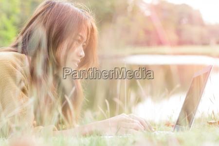 women smile feel happy use laptop