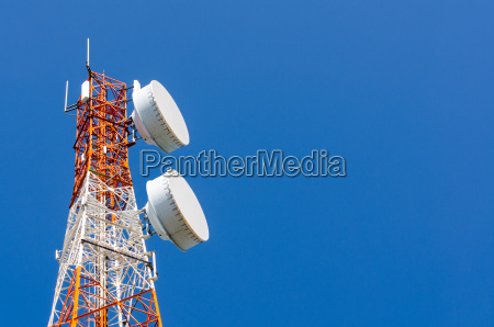 telecommunication tower on blue sky background