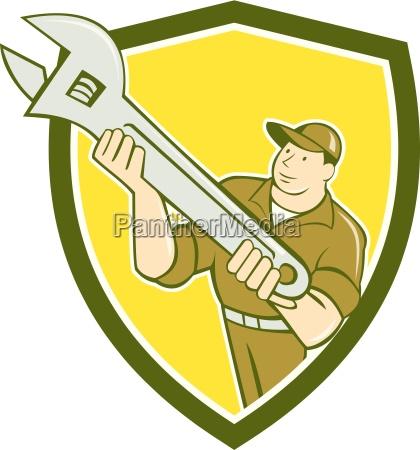 mechanic presenting spanner wrench shield cartoon