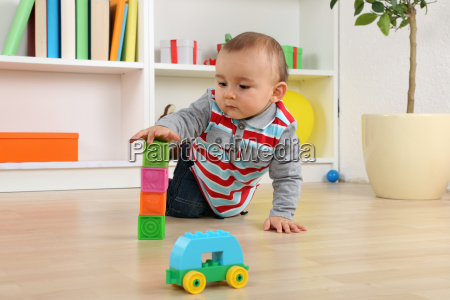 baby playing with blocks cubes