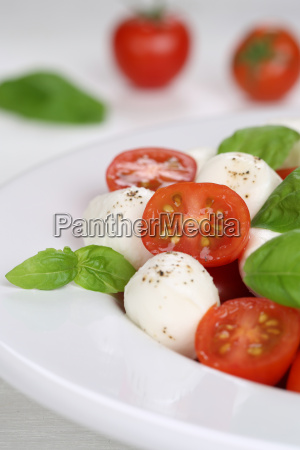 italian caprese salad with tomato and