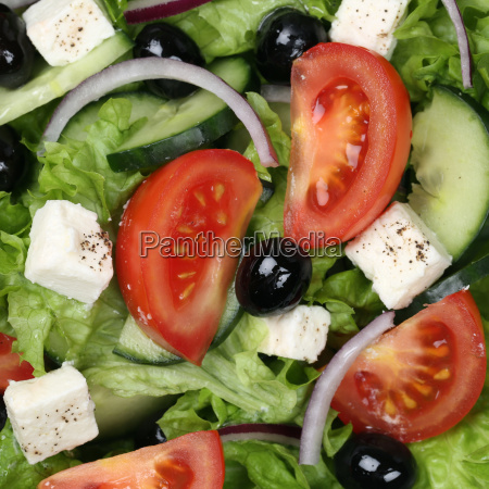background greek salad with tomatoes feta