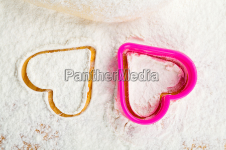 heart shape cookie cutter in flour