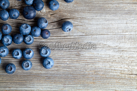 blueberries on a wooden bowl spoon