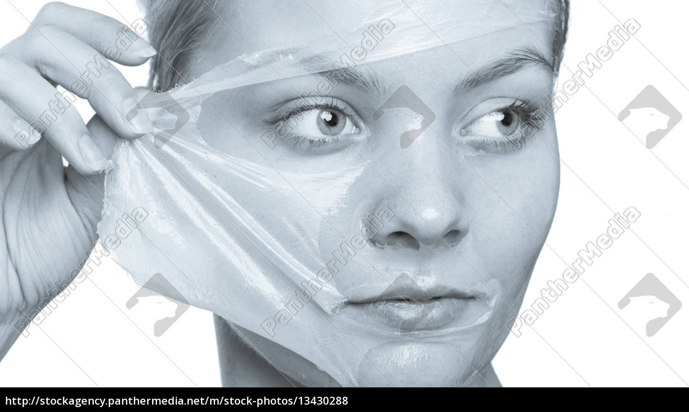 girl, removing, facial, peel, off, mask - 13430288