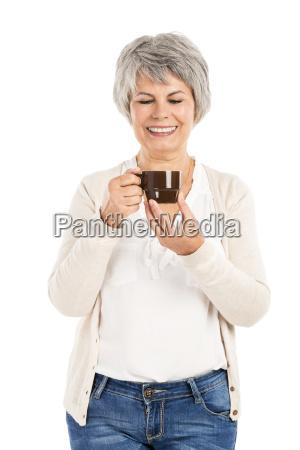 elderly woman drinking coffee