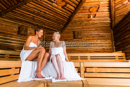 senior and young woman sweating in