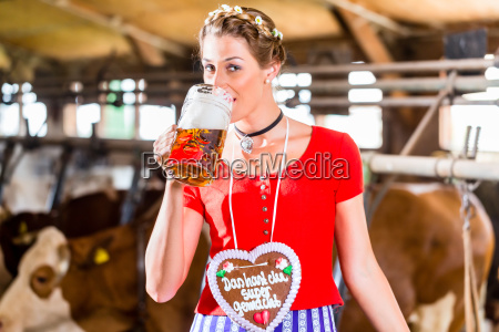 peasant woman drinking beer in the